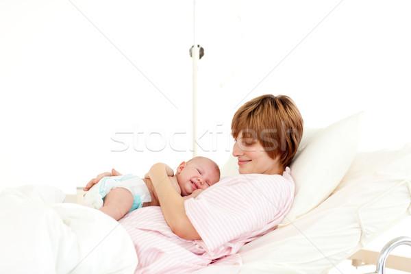 Happy patient with newborn baby in bed Stock photo © wavebreak_media