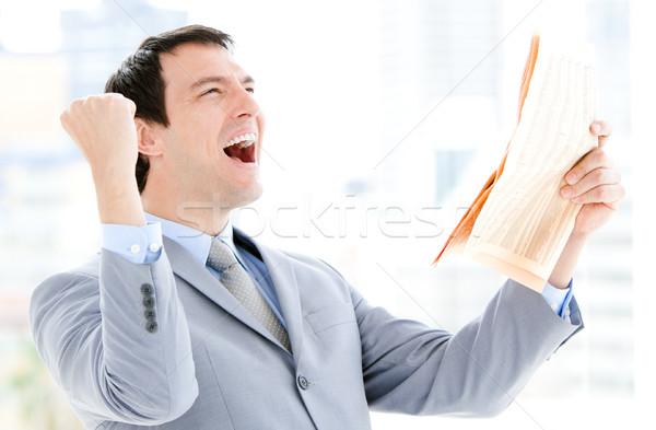 Portrait of a successful businessman reading a newspaper Stock photo © wavebreak_media