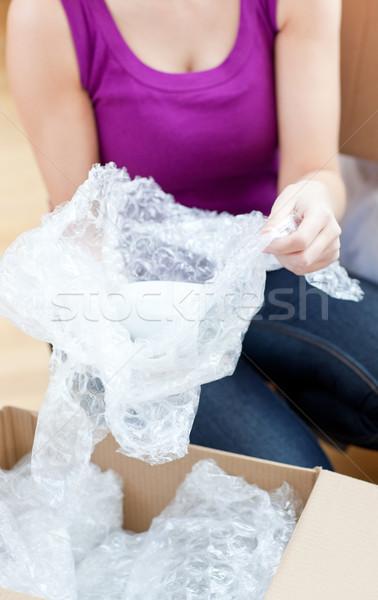 Bright woman unpacking box  Stock photo © wavebreak_media