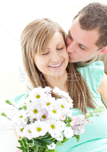 Loving man giving a bunch of flowers to his girlfriend Stock photo © wavebreak_media