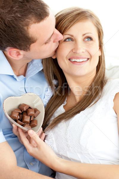 Jóképű férfi csók barátnő tart ül fehér Stock fotó © wavebreak_media