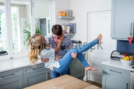 Elragadtatott fiatal nő varr ruházat otthon konyha Stock fotó © wavebreak_media