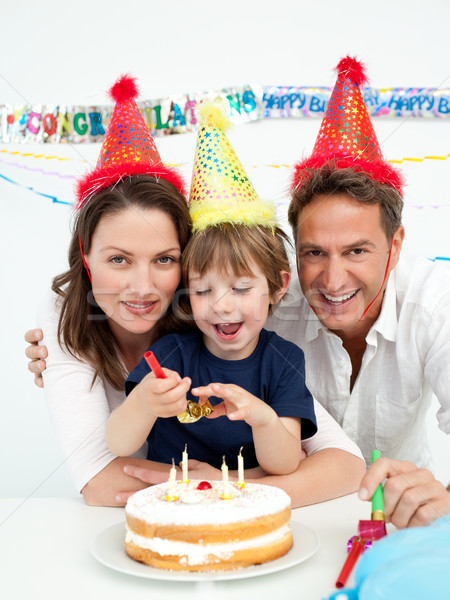 Little boy celebrating his birthday at home with his parents Stock photo © wavebreak_media