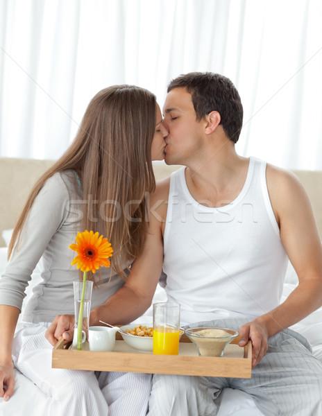 Happy woman kissing her boyfriend for bringing the breakfast Stock photo © wavebreak_media