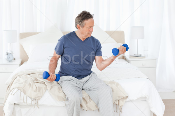 Senior do exercises at home Stock photo © wavebreak_media