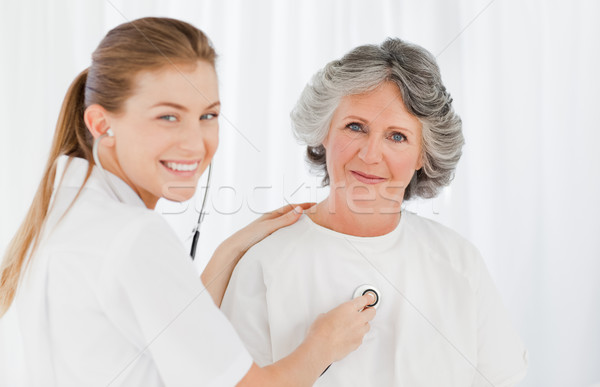Retired patient with her nurse looking at the camera Stock photo © wavebreak_media