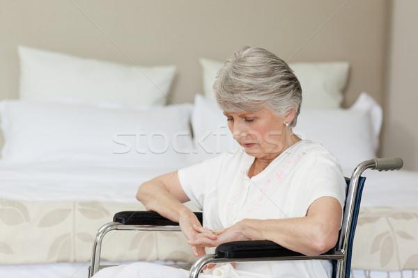 Senior woman asleep in her wheelchair at home Stock photo © wavebreak_media