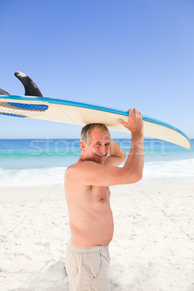 Retired man with his surfboard Stock photo © wavebreak_media