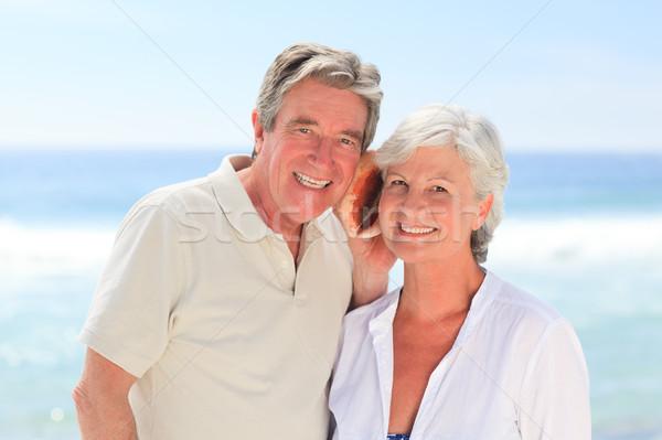 Retraite couple écouter shell homme marche Photo stock © wavebreak_media