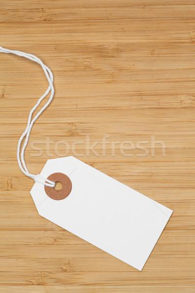 White tag isolated on a desk Stock photo © wavebreak_media