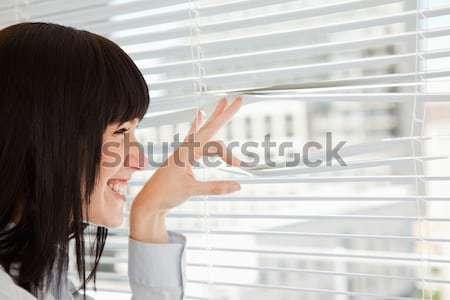 Mosolygó nő ki ablak iroda arc haj Stock fotó © wavebreak_media