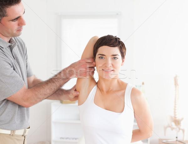 улыбаясь пациент надзор комнату человека спорт Сток-фото © wavebreak_media
