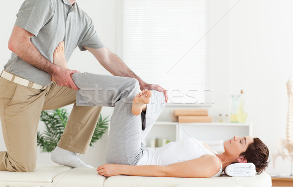 A chiropractor is working with a woman Stock photo © wavebreak_media