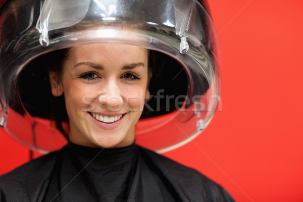 Student under a hairdressing machine while smiling at the camera Stock photo © wavebreak_media