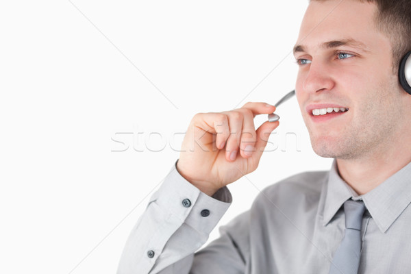 Stock photo: Assistant using a headset against a white background