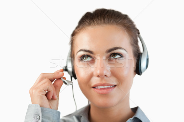 Close up of female call center agent listening closely against a white background Stock photo © wavebreak_media
