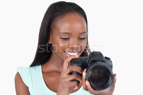 笑みを浮かべて 小さな カメラマン 見 カメラ 白 ストックフォト © wavebreak_media