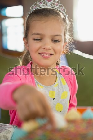 Portrait of a schoolgirl with the thumb up in a classroom Stock photo © wavebreak_media