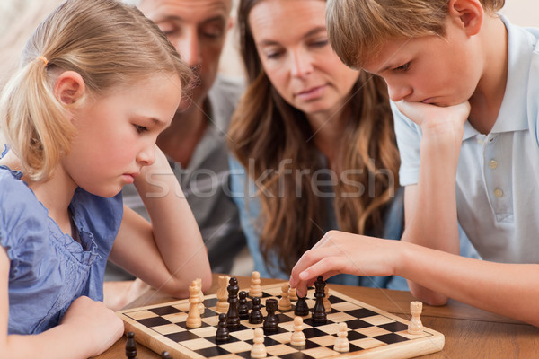 серьезный детей играет шахматам родителей Сток-фото © wavebreak_media
