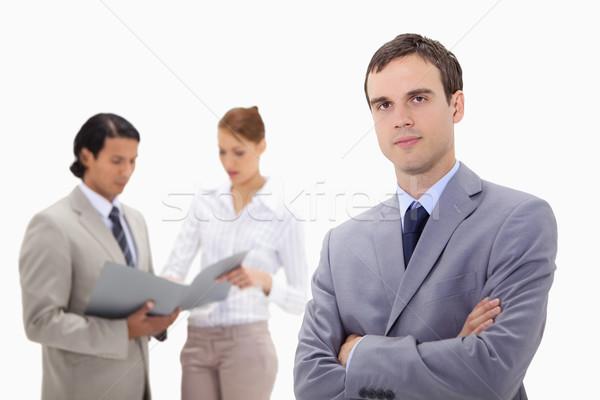 Jonge zakenman praten collega's achter witte Stockfoto © wavebreak_media