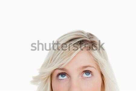 Upper part of the face of a blonde woman looking straight at the camera Stock photo © wavebreak_media