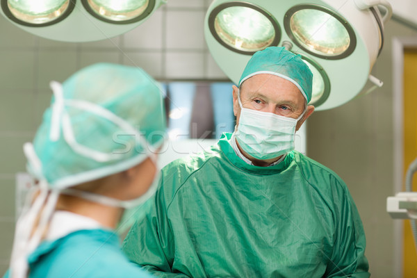 Two surgeons looking at each other in a surgical room Stock photo © wavebreak_media