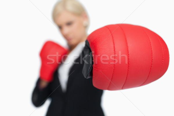 Blond zakenvrouw Rood bokshandschoenen vechten witte Stockfoto © wavebreak_media