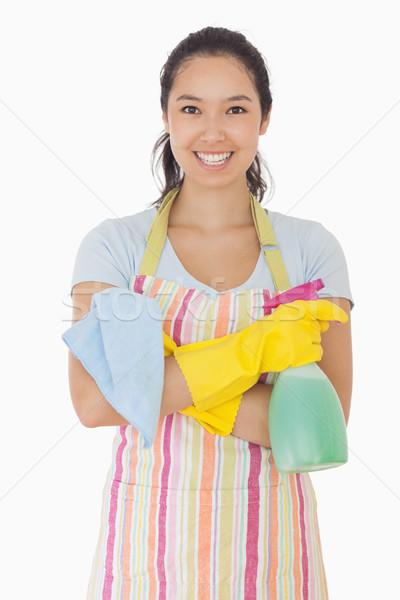 Vrouw permanente handen reinigingsproducten glimlachende vrouw Stockfoto © wavebreak_media