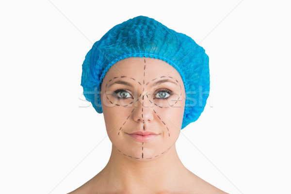 Woman with hair net and black dashes lines for a face lift in the white background Stock photo © wavebreak_media
