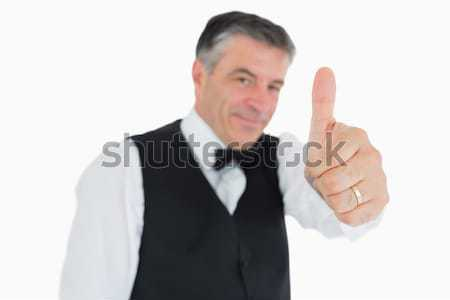 Glad man posing in suit with thumbs up Stock photo © wavebreak_media