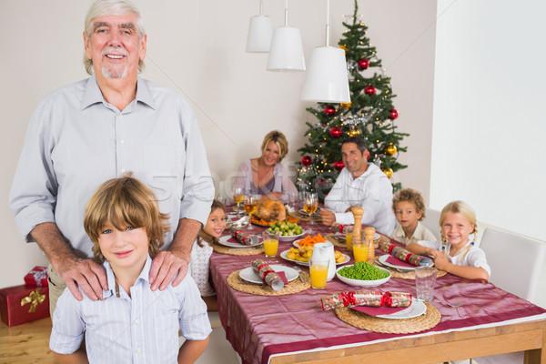 Nagyapa unoka áll vmi mellett ebédlőasztal karácsony Stock fotó © wavebreak_media
