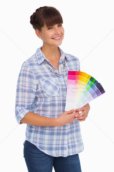 Pretty woman with fringe holding colour charts Stock photo © wavebreak_media