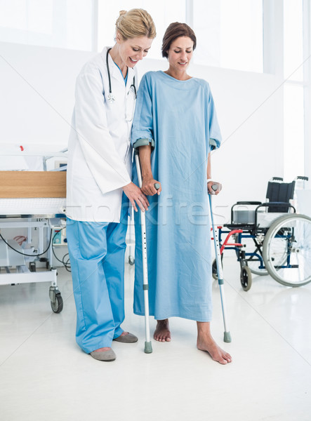 Doctor helping patient in crutches at the hospital Stock photo © wavebreak_media