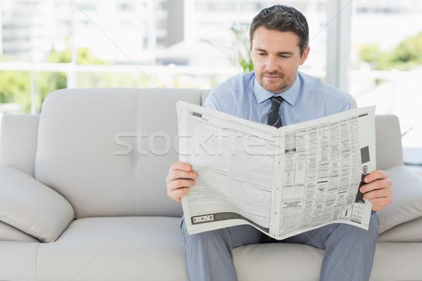 Well dressed man reading newspaper at home Stock photo © wavebreak_media