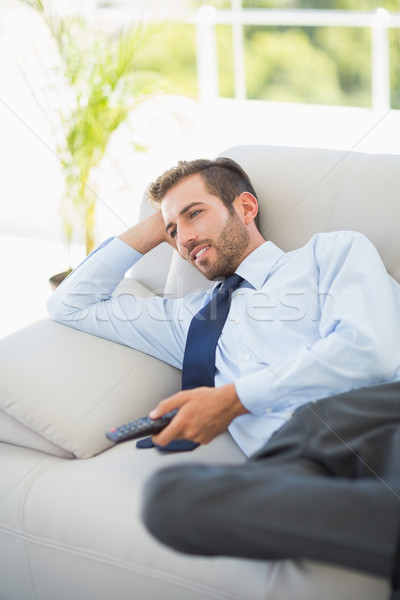Well dressed man watching tv in living room Stock photo © wavebreak_media