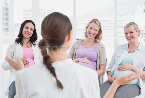 Pregnant women listening to doctor at antenatal class Stock photo © wavebreak_media