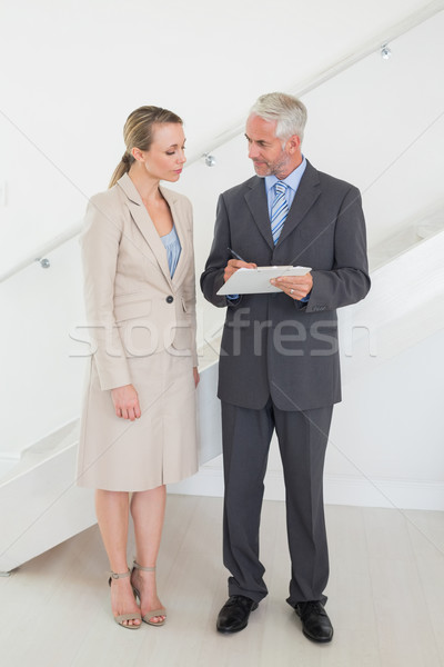 Estate agent going over contracts with customer Stock photo © wavebreak_media