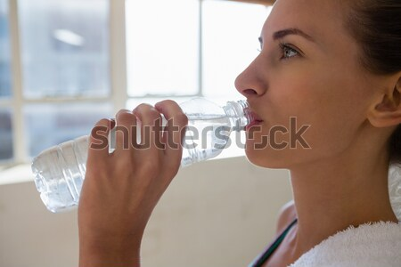 Casual businesswoman smoking an electronic cigarette Stock photo © wavebreak_media