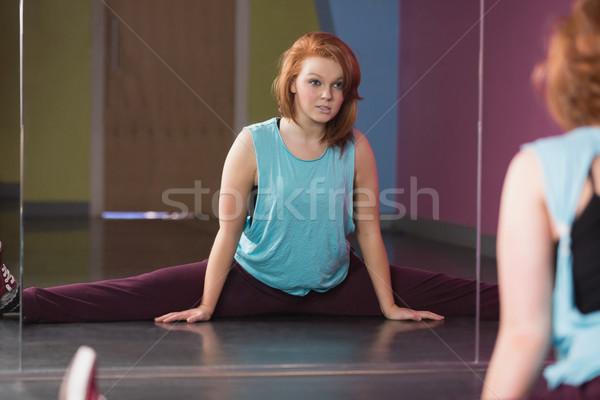 Pretty break dancer doing the splits looking in mirror Stock photo © wavebreak_media
