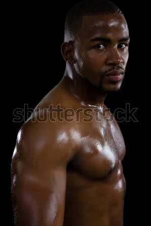 Muscular man in hood jacket Stock photo © wavebreak_media