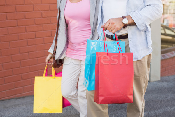 Happy mature couple walking with their shopping purchases Stock photo © wavebreak_media