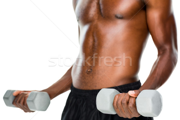 Mid section of fit shirtless man lifting dumbbells Stock photo © wavebreak_media