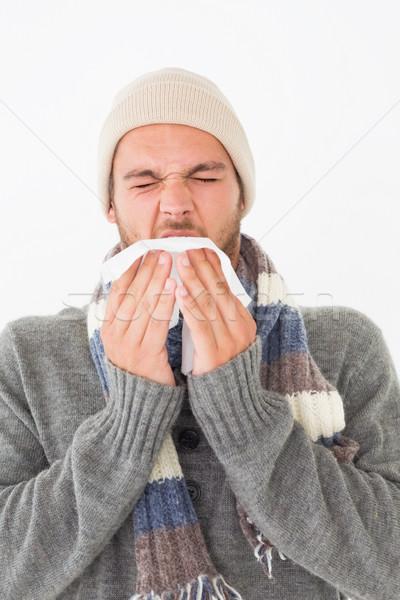 Young man in warm clothing sneezing Stock photo © wavebreak_media