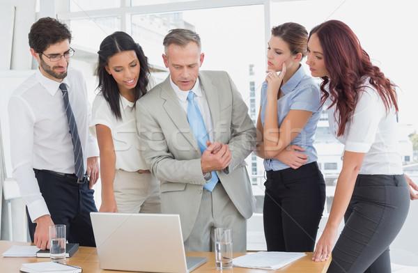 Business team using a laptop Stock photo © wavebreak_media