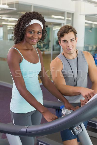 Uygun kadın ayak değirmeni konuşma personal trainer spor salonu Stok fotoğraf © wavebreak_media