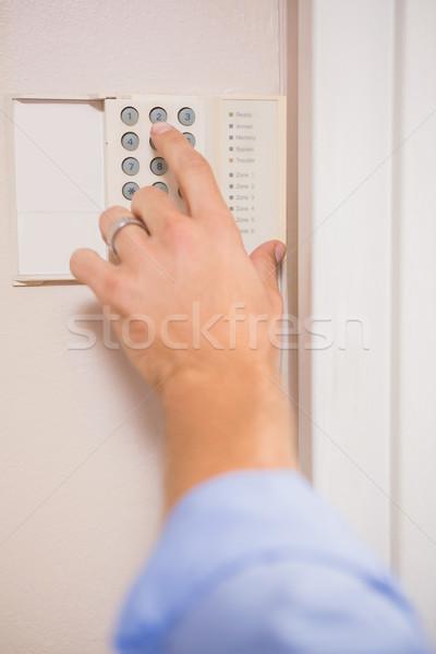 Adam ev Alarm duvar ev el Stok fotoğraf © wavebreak_media