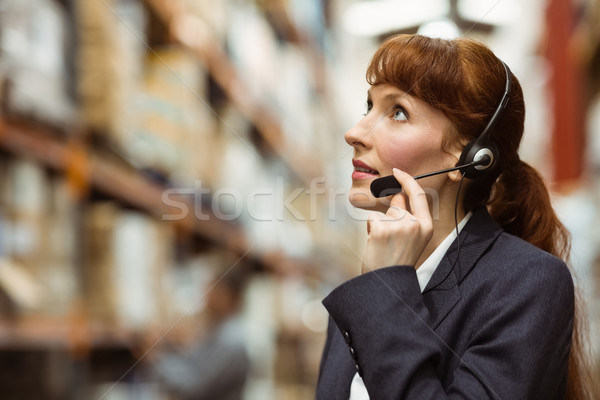 Pretty businesswoman speaking in a headset Stock photo © wavebreak_media