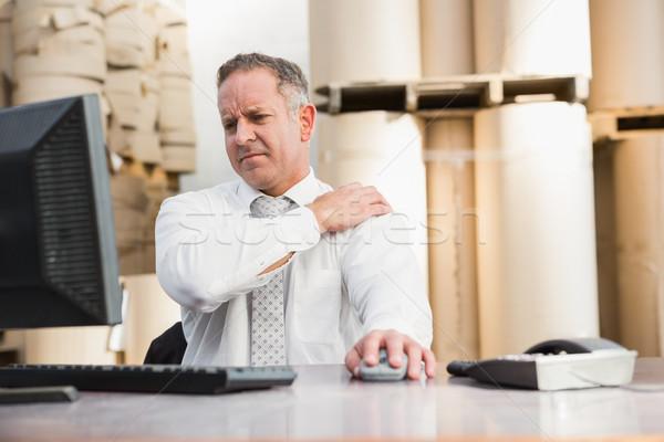 Armazém gerente sofrimento dor no ombro grande negócio Foto stock © wavebreak_media