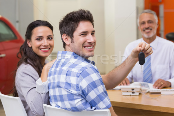 Stock photo: Smiling couple holding their new car key