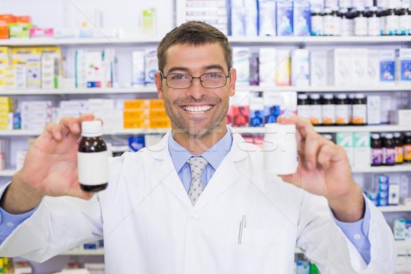 Pharmacist showing medicines jar Stock photo © wavebreak_media